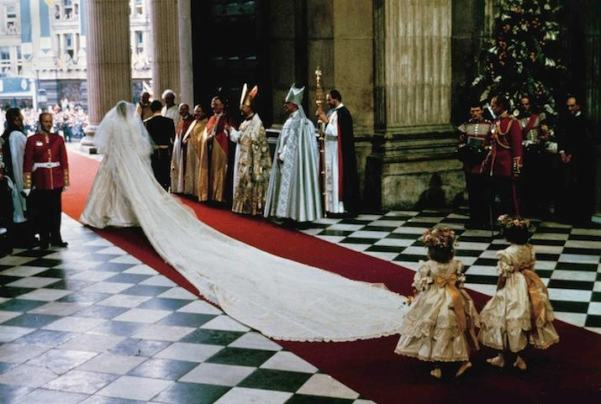 With a 25-foot (7.6 meter) sweeping train, The Princess of Wales, former Lady Diana Spencer, leaves St. Paul's Cathedral arm in arm with Prince Charles at the end of their wedding ceremony in London, July 29, 1981. (AP Photo)